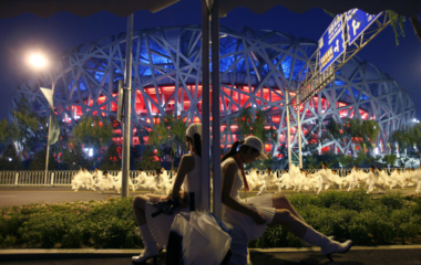Performers wait before the last rehearsal for the opening ceremony of the Beijing 2008 Olympic Games