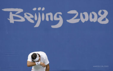 Spain's Nadal wipes his face as he attends a tennis practice session ahead of the Beijing 2008 Olympic Games