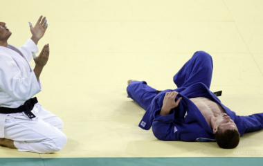 Boqiev of Tajikistan celebrates after defeating van Tichelt of Belgium during their men's -73kg final of the repechages judo match at the Beijing 2008 Olympic Games