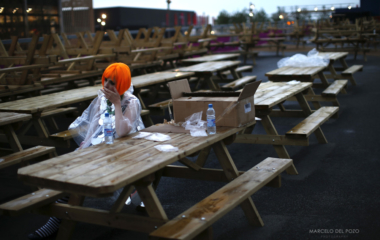 A performer sits as she wait before the start of the 2012 Olympic Games opening ceremony, next to the Olympic Stadium at the Olympic Park in London