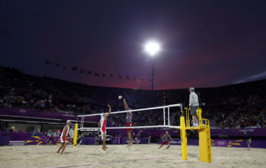 Switzerland's Sascha Heyer spikes the ball as Russia's Konstantin Semenov jumps to block it during their men's preliminary round beach volleyball match at the London 2012 Olympic Games at Horse Guards Parade