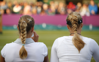 Germany's Lisicki and Kerber rest during break in their women's doubles tennis match against Serena and Venus Williams of the U.S. at the All England Lawn Tennis Club during the London 2012 Olympic Games