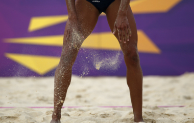 Brazil's Juliana Silva dusts off sand from her legs during their women's preliminary round beach volleyball match against Czech Republic's Hana Klapalova and Lenka Hajeckova at Horse Guards Parade during the London 2012 Olympic Games