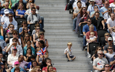 Spectators watch the men's round of 16 beach volleyball match at Horse Guards Parade during the London 2012 Olympic Games