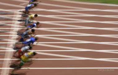 Athletes run during the men's 100 metres event at the Athens 2004 Olympic Games.