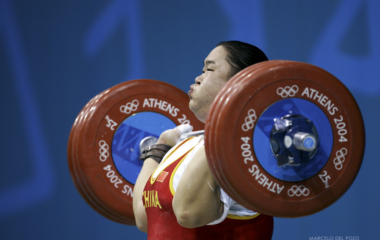 China's Tang Gonghong powers a lift in the women's +75 kg weightlifting event at the Athens 2004 ...