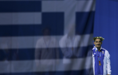 Greece's Pyrros Dimas stands on the podium in the men's 85 kg weightlifting event at the Athens 2004 ...
