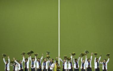 Germany's players celebrate celebrate on the podium after winning women's field hockey final match ...