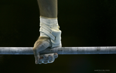 U.S. Brett McClure performs a routine on the horizontal bar during the men's artistic gymnastics dur..