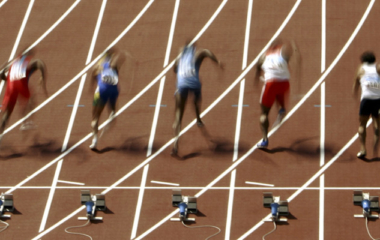 Athletes run during the men's 100 metres heats 3 at the Athens 2004 Olympic Summer Games August 21, ..