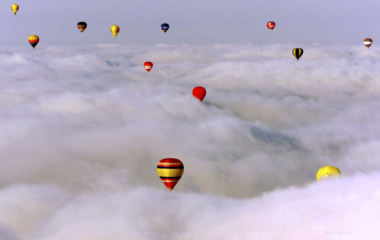 HOT AIR BALLOONS FLY OVER CLOUDS IN SEVILLE