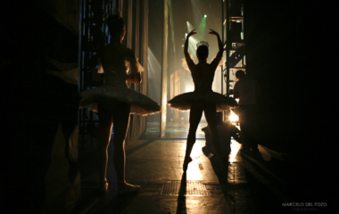 "Ballet dancers from the English National Ballet warm up as they watch backstage the first act of ""Cinderella"" in Seville"